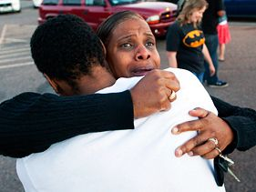 Victims' family members mourn in Denver on Friday