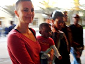 Charlize Theron shows off her newly shaved head in Namibia on June 24