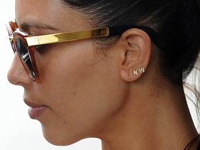 Kim Kardashian sports &quot;KW&quot; earrings while in New York