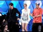 Andy Samberg, Leighton Meester, and Adam Sandler photographed on stage while presenting the Best Kiss award at the 2012 MTV Movie Awards in Los Angeles.
