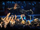 Kevin Hart proves his faith in the fans by spontaneously stage diving during his opening monologue.