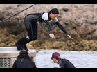 "Jennifer Lawrence takes a dive on the set of ""Catching Fire"" in Maui, Hawaii on November 26"